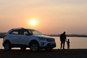 silhouette-of-man-and-child-near-white-hyundai-tucson-suv-1134857
